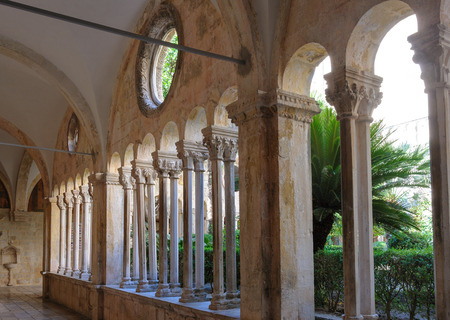 individualized: DUBROVNIK, CROATIA - SEPTEMBER 1, 2009: Double column colonnades with individualized capitals along the cloister of the Franciscan monastery Editorial