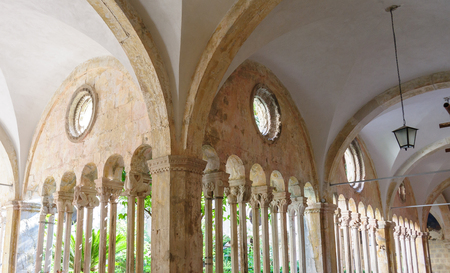 DUBROVNIK, CROATIA - SEPTEMBER 1, 2009: Double column colonnades with individualized capitals along the cloister of the Franciscan monastery Editorial