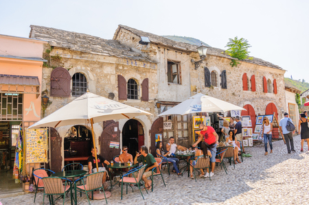 cafeterias: MOSTAR, BOSNIA AND HERZEGOVINA - SEPTEMBER 1, 2009: Old houses converted to shops and cafeterias Editorial