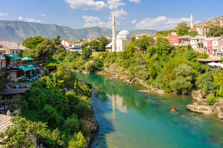 mehmed: MOSTAR, BOSNIA AND HERZEGOVINA - SEPTEMBER 1, 2009: Neretva river and the Koski Mehmed Pasha mosque on the Bosnian east side Editorial