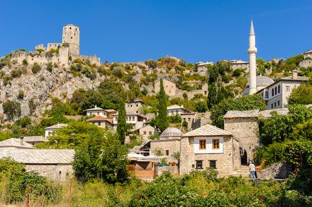 neretva: POCITELJ, BOSNIA AND HERZEGOVINA - SEPTEMBER 1, 2009: Historic town located on a karst landscape next to the Neretva river, with the Kula fort and Hajji Alija mosque. Editorial