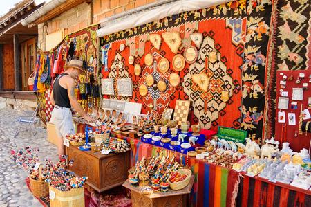 MOSTAR, BOSNIA AND HERZEGOVINA - SEPTEMBER 1, 2009: Old town east side street vendor
