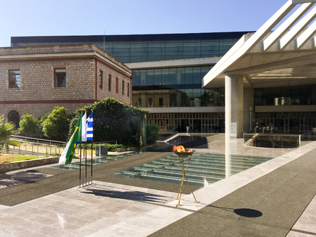 olympiad: ATHENS, GREECE - APRIL 27, 2016: The Olympic flame on its way to the Rio de Janeiro Summer Olympics, makes a brief stop in front of the New Acropolis Museum.