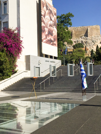 summer olympics: ATHENS, GREECE - APRIL 27, 2016: The Olympic flame on its way to the Rio de Janeiro Summer Olympics, makes a brief stop in front of the New Acropolis Museum.