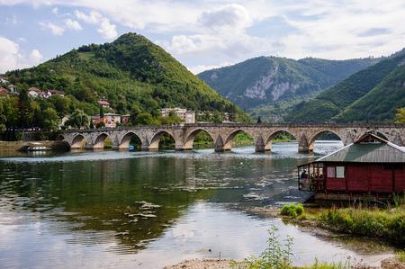 visegrad: VISEGRAD, BOSNIA AND HERZEGOVINA - SEPTEMEBER 4, 2009: Mehmed Pasa Sokolovic bridge constructed between 1571 and 1577 by architect and engineer Mimar Sinan.