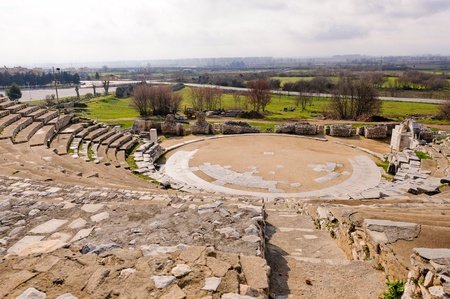 colonization: KRINIDES, GREECE - FEBRUARY 25, 2010: Ancient Greek theater of Philippi which later served as an arena for beast fights during Roman colonization