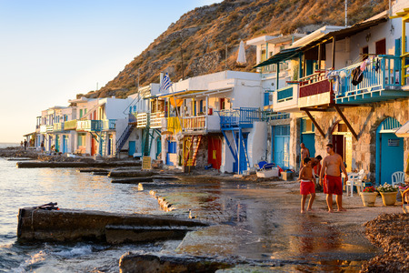kyklades: MELOS, GREECE - SEPTEMBER 2, 2012: Klima, a traditional fishing village with 2-storey houses called Syrmata built in the concavities of the rocks. The ground floor housed the fishermens boats. Editorial