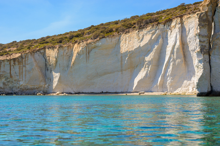 kyklades: Small beach strip at Kleftiko in southwest Melos, Greece, accessible only by sea and dangerous due to risk of rockfall.