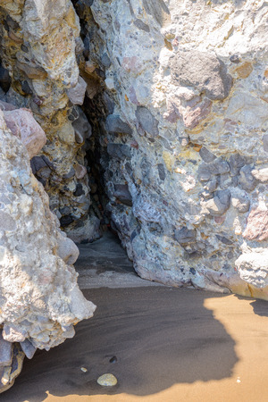 kyklades: Colorful volcaniclastic rock formations over small bights within Gerontas cove in Melos, Greece.