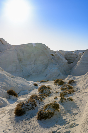 moonscape: Sarakiniko, Melos, Greece. Complex shapes and gullies formed by water flowing into the gorge and out to sea between soft white rocks has carved out the stream bed into a moonscape. Stock Photo
