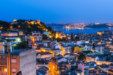 A view of the Alfama downtown at night in Lisbon, Portugal photo