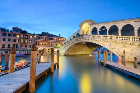 Rialto bridge at night in Venice, Italy photo