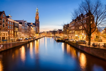 The Westerkerk church in Amsterdam, Netherlands at night photo