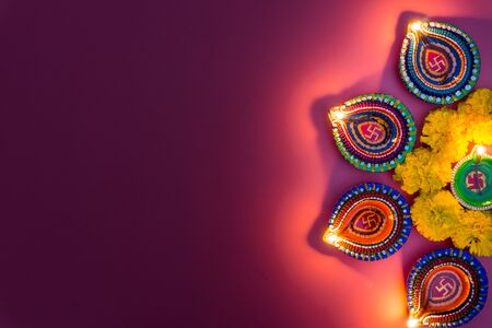 Indian festival Diwali, Diya oil lamps lit on colorful rangoli. Hindu traditional. Happy Deepavali. Copy space for text.