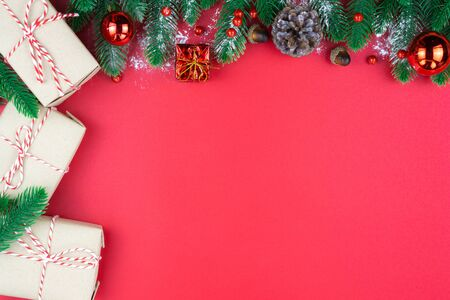 Christmas holidays composition, top view of red Christmas decorations on red background with copy space for text. Flat lay, winter, postcard template, new year concept.