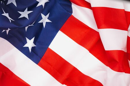 US American flag on white background. For USA Memorial day, Memorial day, Presidents day, Veterans day, Labor day, Independence day, or 4th of July celebration. Top view, copy space for text.