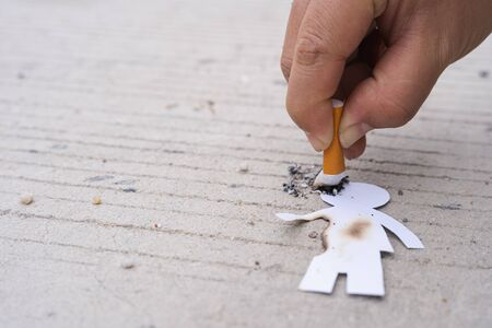 Paper cut of man destroyed by cigarette. Smoking destroying life concept. Quit smoking for life on world tobacco day.