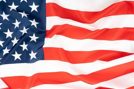 US American flag on white background. For USA Memorial day, Presidents day, Veterans day, Labor day, Independence or 4th of July celebration. Top view, copy space for text.