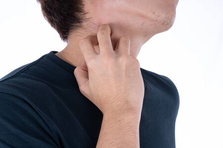 Male scratching his neck on isolated white background. Medical, healthcare for advertising concept.