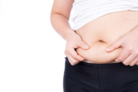 Fat woman holding excessive fat belly, overweight fatty belly isolated on over white background. Diet lifestyle, weight loss, stomach muscle, healthy concept.