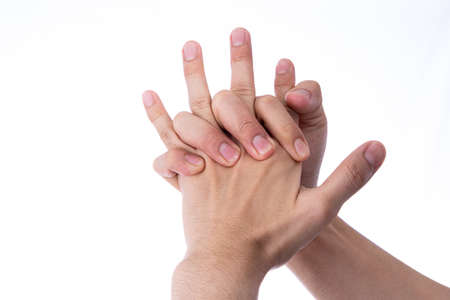 Man hand massaging his hand and fingers isolated white background. Medical, healthcare for advertising concept. 免版税图像