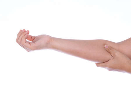 Woman hand holding her elbow isolated white background. Medical, healthcare for advertising concept. 免版税图像
