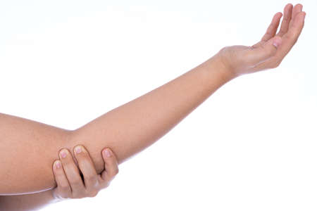 Woman hand holding her elbow isolated white background. Medical, healthcare for advertising concept. Stock Photo