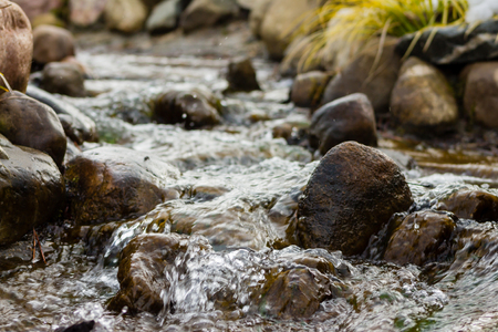 Water over rocks in a stream 写真素材