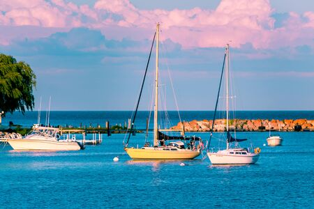 Sail boats docked at the marina at Mackinac Island during sunset