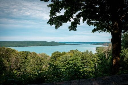 Looking out over Sleeping Bear Dunes National Lakeshore Park while hiking through the woods