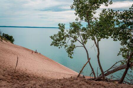 People climbing up the Sleeping Bear Dunes from Lake Michigan