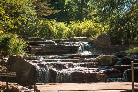 Waterfall in the statue garden at the Frederik Meijer Gardens in Grand Rapids Michigan in the summer