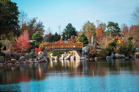 Landscape shot of the bridge at the japanese gardens in Grand Rapids Michigan during the fall Stock fotó