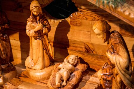 Holy family in a wooden nativity scene during Christmas time Stock fotó