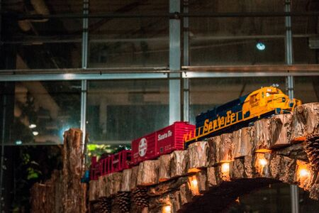 Model train running through the greenhouse at the railroad garden