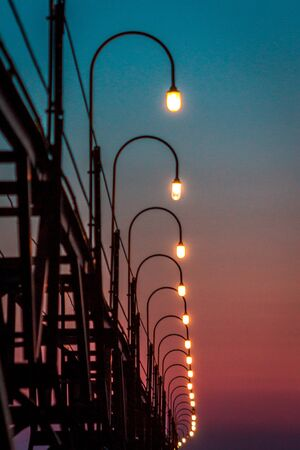 Lights along the South Haven pier during blue hour