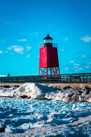 The red light house in Charlevoix Michigan shot from a frozen over beach