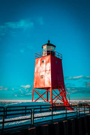 Prime look at bold red South Pier Lighthouse in Charlevoix Michigan in winter 版權商用圖片