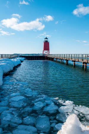 Melting ice sheets near the light house in Charlevoix Michigan