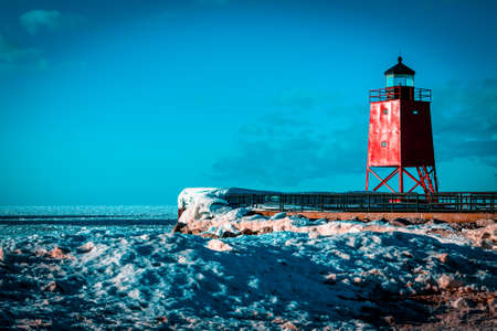 Charlevoix Michigans South Pier Lighthouse frozen over in winter