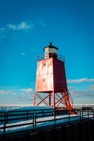 Prime look at bold red South Pier Lighthouse in Charlevoix Michigan