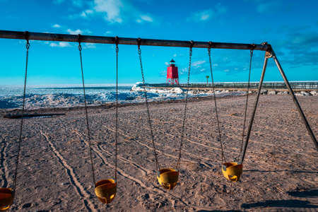 A shot of Charlevoix Michigan beach through a swingset