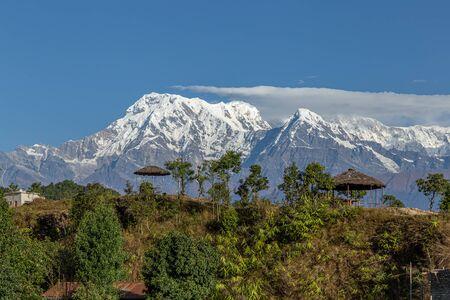 Himalaya Peaks behind pavilions in Nepal