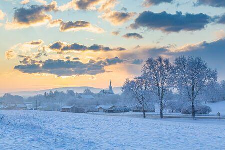 Snowy Sunrise Over A  Rural Church
