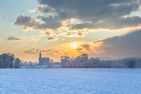 Winter Sunrise Over A Rural Church