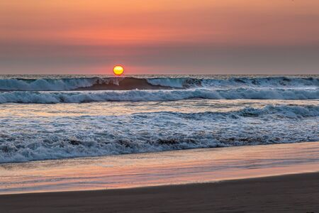 Sunset over the waves of the Pacific Ocean in Guatemala