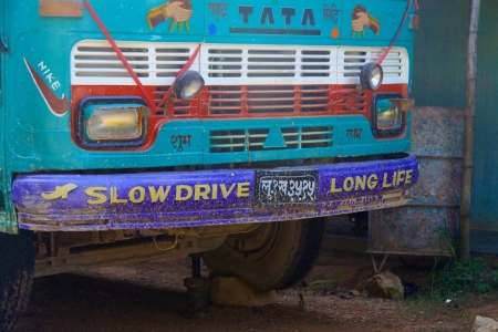 Slow Drive Long Life - Bus in Nepal Editorial