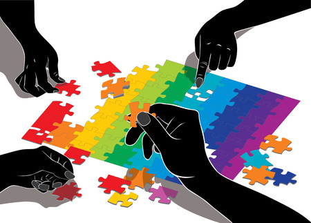 composing: Hands composing multi-color puzzle. Teamwork.