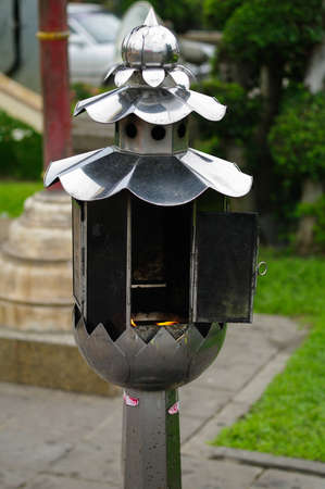 Candle handle in a temple in Thailand