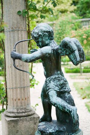 little cupid in the garden